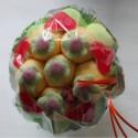 Bouquet de fleurs en bonbons vert/orange fleurs vertes
