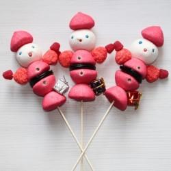 Père Noël et son paquet cadeau en brochette de bonbons
