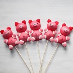 Brochette de bonbons cochon