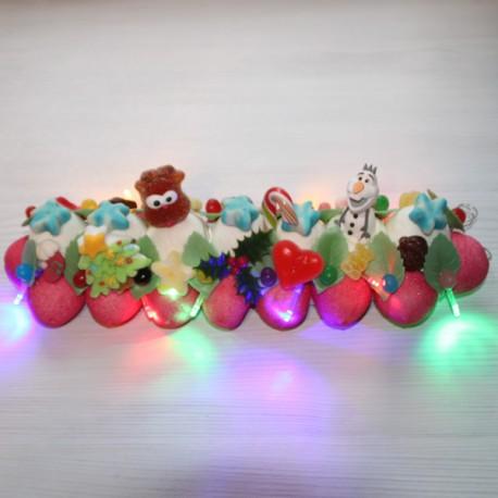 Bûche de Noël en bonbons avec guirlande leds